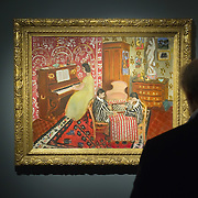 "BRESCIA, ITALY - FEBRUARY 11:  A visitor admires ""Pianist and Checker Players"" by Matisse at the  Santa Giulia Museum on February 11, 2011 in Brescia, Italy. The exhibition ""Matisse La Seduzione di Michelangelo"" shows  180 works of the French artist and will stay open until June 12th 2011"