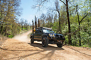 Oklahoma TAT - Bill and Susan Dragoo drive their highly modified Toyota Tacoma truck along the Trans America Trail in eastern Oklahoma. This trail stretches from eastern Tennessee to the coast of Oregon, nearly all of the route on dirt roads and trails.