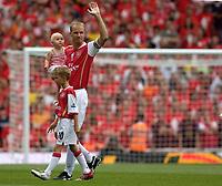 Photo: Daniel Hambury.<br />Arsenal v Ajax. Dennis Bergkamp Testimonial. 22/07/2006.<br />Arsenal's Dennis Bergkamp with his kids before kick off.