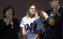 September 11, 2016 - U.S. - ASEC -- Lynette Rodriguez-Giannelli, center, of Albuquerque, gets applause from Governor Susana Martinez, left, and Albuquerque Fire chief David Downey, right, after she spoke at the city of Albuquerque 9/11 Memorial Ceremony in Civic Plaza on Sunday, September 11, 2016. Her father Anthony Rodriguez, a firefighter out of Red Hook Brooklyn was killed on 9/11. She was 17 at the time. (Credit Image: © Greg Sorber/Albuquerque Journal via ZUMA Wire)