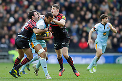 Northampton Lock (#5) Courtney Lawes is tackled by Saracens Scrum-Half (#9) Neil de Kock ans Outside Centre (#13) Joel Tomkins during the first half of the match - Photo mandatory by-line: Rogan Thomson/JMP - Tel: Mobile: 07966 386802 30/12/2012 - SPORT - RUGBY - stadiummk - Milton Keynes. Saracens v Northampton Saints - Aviva Premiership.