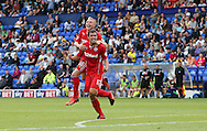 JAMES BOARDMAN / 07967642437<br /> Crawley's  Joe Walsh celebrates scoring with Nicky Adams during the Sky Bet Division One match between Tranmere Rovers and Crawley Town at Prenton Park in Birkenhead, Merseyside. August 10, 2013.