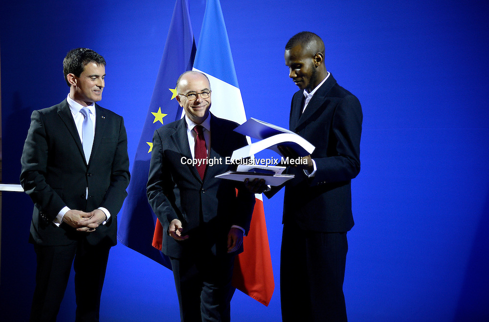 'Hero' Muslim employee who saved lives at Kosher supermarket in Paris praised for his courage as he is granted citizenship by France<br /> <br /> The Muslim kosher supermarket employee who saved several shoppers lives during the Paris attack has been granted French citizenship.<br /> Lassana Bathily, 24, was praised for his 'courage and heroism' by Interior Minister Bernard Cazeneuve during a ceremony in the presence of Prime Minister Manuel Valls.<br /> Mr Cazeneuve said Mali-born Bathily's 'act of humanity has become a symbol of an Islam of peace and tolerance.'<br /> <br /> <br /> 'Tonight I'm very proud and deeply touched,' Mr Bathily, who went to school in Paris, said with tears in his eyes.<br /> He humbly stressed that he does not consider himself a hero, saying: 'I am Lassana. I'll stay true to myself.'<br /> <br /> <br /> 'People are all equal to me and skin color isn't a matter. France is the country of human rights,' he added.<br /> Mr Bathily was in the store's underground stockroom when gunman Amedy Coulibaly burst in to the Hyper Cacher supermarket in Porte de Vincennes, Paris, on January 9 and killed four people.<br /> The 24-year-old guided terrified customers to safety in a supermarket chiller and has since been praised around the world for his quick-thinking and bravery.<br /> <br /> Photo shows: Selfless: When gunman Amedy Coulibaly entered the shop, Lassana Bathily turned off the freezer and hid shoppers inside before sneaking out and helping police free the hostages<br /> ©Exclusivepix Media