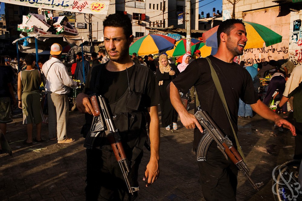 Hamas security force policemen patrol a neighborhood market August 06, 2007 in Gaza City, Gaza. More than 1,000 Hamas policemen are highly visible throughout Gaza these days, community policing with an emphasis on cracking down on armed gunmen, smugglers and thugs.
