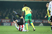 Brentford defender Nico Yennaris (8) with a nasty fall during the EFL Sky Bet Championship match between Brentford and Norwich City at Griffin Park, London, England on 31 December 2016. Photo by Matthew Redman.