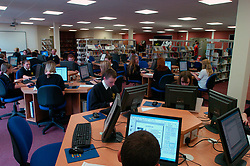 New IT facilities at Burnside Secondary School; Business & Enterprise College - a community school; Wallsend Newcastle,  Students at work on computers in the library area; 2004 UK