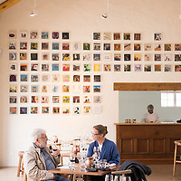 A couple tastes wines at the Spier Wine Farm in Stellenbosch, South Africa.