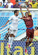 Gianluigi Buffon of Italy and &Aacute;lvaro Gonz&aacute;lez of Uruguay during the 2014 FIFA World Cup match at Arena das Dunas, Natal<br /> Picture by Stefano Gnech/Focus Images Ltd +39 333 1641678<br /> 24/06/2014