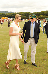 Asprey World Class Cup polo held at Hurtwood Park Polo Club, Ewhurst, Surrey on 17th July 2010.<br /> Picture shows:- PRINCE ALBERT OF MONACO  and CHARLENE WITTSTOCK treading in.