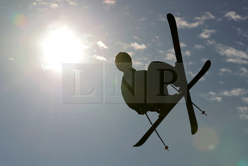 © Licensed to London News Pictures. 28/10/2011, London, UK.  A freestyle skier jumps during the Battle of Britain freestyle ski competition at the Freeze Snowboard and Ski Festival at Battersea Power Station in London, Friday, Oct. 28, 2011. Photo credit : Sang Tan/LNP