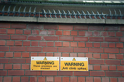 Anti climb spikes on top of brick wall intended to prevent crime,