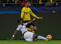 Football - 2018 / 2019 UEFA Champions League - Round of Sixteen, Second Leg: Borussia Dortmund (0) vs. Tottenham Hotspur (3)<br /> <br /> Serge Aurier (Tottenham FC) dives in to stop the run of Abdou Diallo (Borussia Dortmund) at Signal Iduna Park (Westfalenstadion).<br /> <br /> COLORSPORT/DANIEL BEARHAM