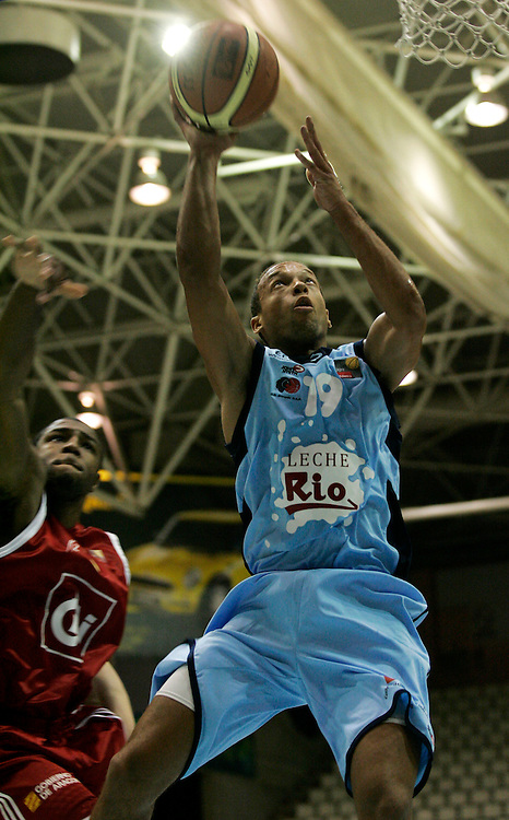 (Lugo, Spain - October 9, 2009) - CB Breogan guard Jeff Xavier leaps toward the hoop for a lay-up in the first half. CAI Zaragoza forward Chinemelu ElonuCB Breogan beats league favorites, CAI Zaragoza, 72-63 in their home opener Friday at the Pazo dos Deportes in Lugo...Photo by Will Nunnally / Will Nunnally Photography