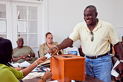 Weston Phillips draws #7 for Justin Harrigan, Sr. for Office of the Senate, St. Thomas/St. John District.  Casting of Lots for the Primary Election of September 8, 2012.  Election Sytem of the Virgin Islands.  21 August 2012.  © Aisha-Zakiya Boyd