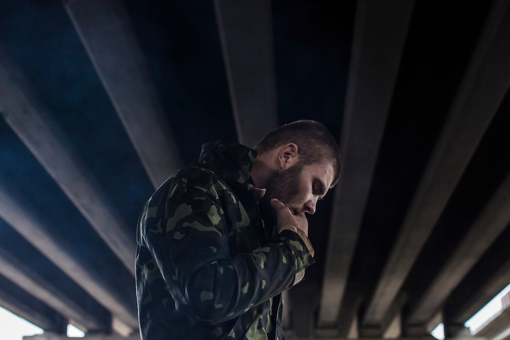 PERVOMAISKE, UKRAINE - NOVEMBER 18, 2014: A member of the 5th platoon of the Dnipro-1 brigade, a pro-Ukraine militia, at their post underneath a bridge in Pervomaiske, Ukraine. CREDIT: Brendan Hoffman for The New York Times
