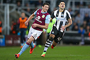 Aston Villa defender Tommy Elphick(6) and Newcastle United forward Aleksandar Mitrovic (45)  during the EFL Sky Bet Championship match between Newcastle United and Aston Villa at St. James's Park, Newcastle, England on 20 February 2017. Photo by Simon Davies.