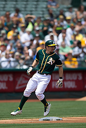 OAKLAND, CA - JULY 23:  Billy Burns #1 of the Oakland Athletics stands on third base against the Toronto Blue Jays during the third inning at O.co Coliseum on July 23, 2015 in Oakland, California. The Toronto Blue Jays defeated the Oakland Athletics 5-2. (Photo by Jason O. Watson/Getty Images) *** Local Caption *** Billy Burns
