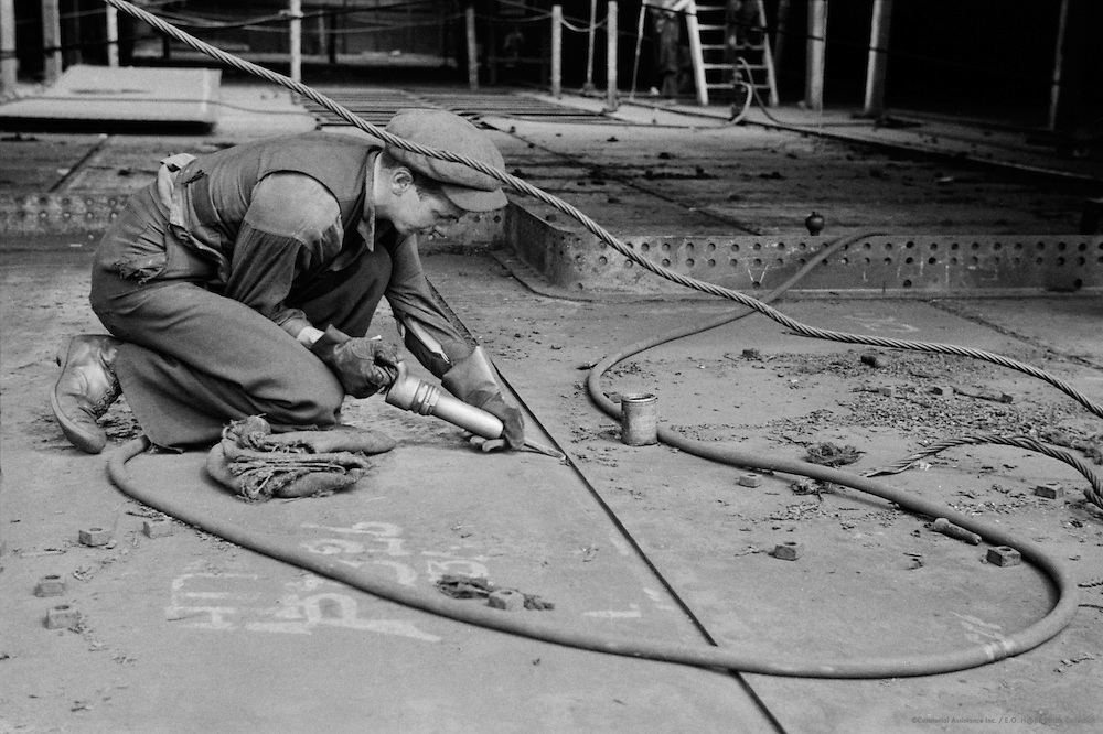 Worker Rivetting, Cunard Lines, England, 1934