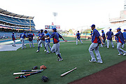 ANAHEIM, CA - AUGUST 18:  The Texas Rangers warm up before the game against the Los Angeles Angels of Anaheim on August 18, 2011 at Angel Stadium in Anaheim, California. The Angels won the game 2-1. (Photo by Paul Spinelli/MLB Photos via Getty Images)