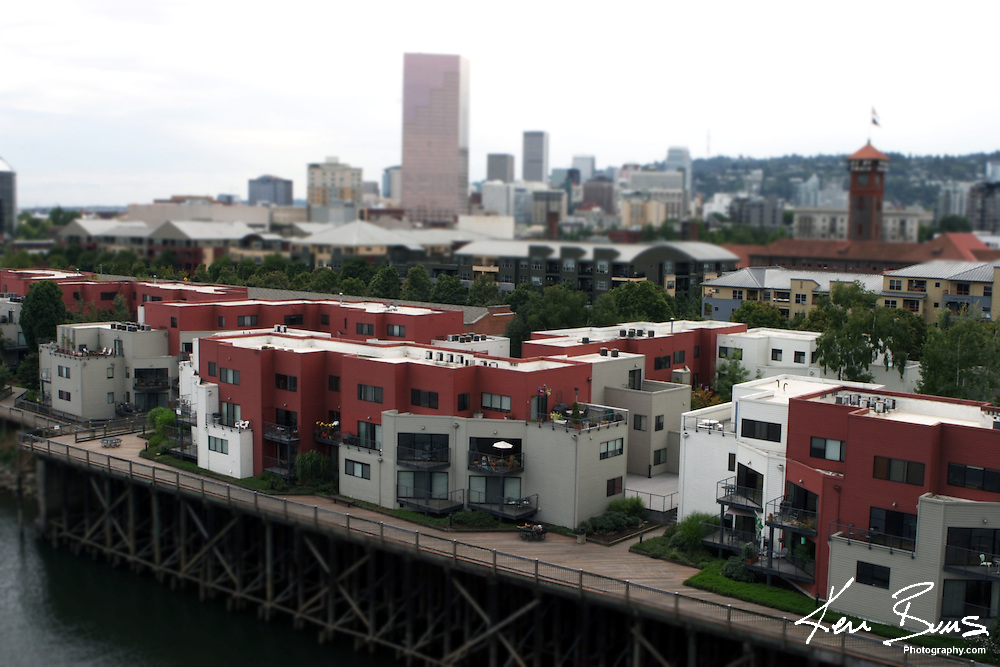 Portland Condo's overlooking the Willamette River. Focus makes the buildings look miniature.