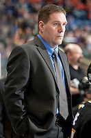 KELOWNA, CANADA - JANUARY 26: Steve Young, head coach of the Prince Albert Raiders stands on the bench at the Kelowna Rockets on January 26, 2013 at Prospera Place in Kelowna, British Columbia, Canada (Photo by Marissa Baecker/Shoot the Breeze) *** Local Caption ***
