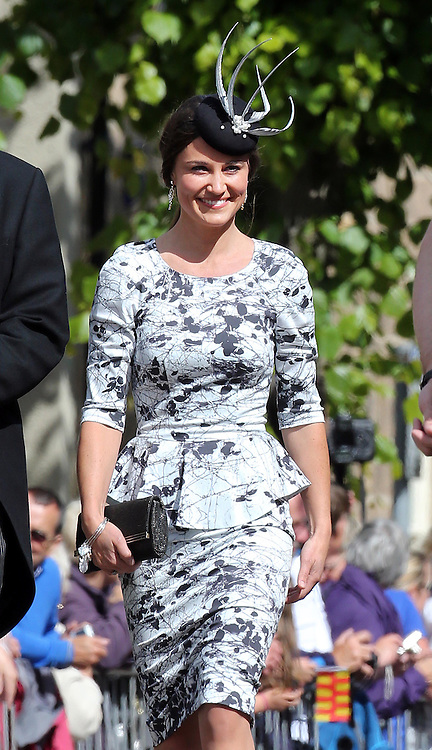 Pippa Middleton  arriving at the Lady Melissa Percy and Thomas van Straubenzee wedding at St.Michaels Church, Alnwick, Northumberland after their wedding ,Saturday, 22nd June 2013<br /> Picture by:  Stephen Lock / i-Images