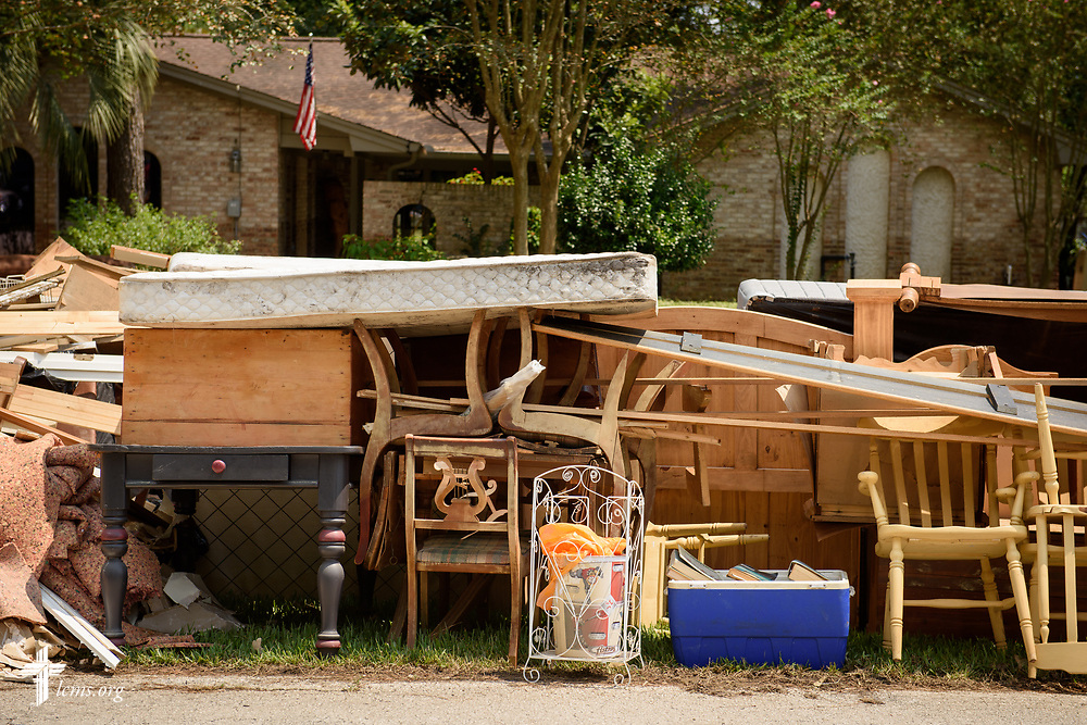 Furniture and gutted building materials in the aftermath of Hurricane Harvey line a residential street on Saturday, Sept. 2, 2017, in Spring, Texas. LCMS Communications/Erik M. Lunsford