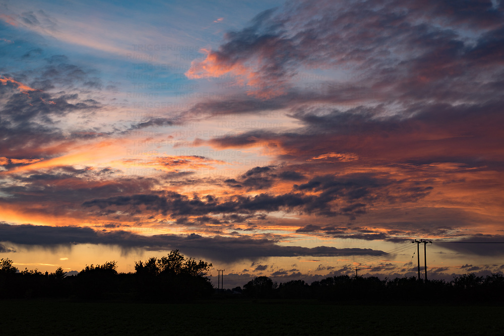 Summer evening sky over English countryside