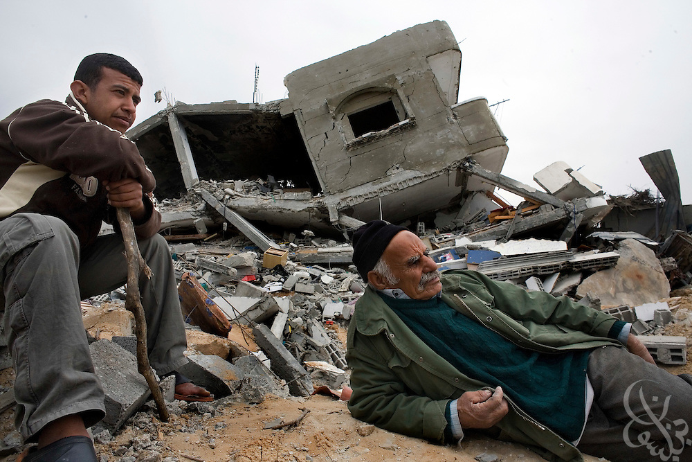 Abdullah Moslah (r), age 65, lies idle in front of the rubble that was his family home January 23, 2009 in the Juhor al-Dik neighborhood southeast of Gaza City. Moslah is now homeless after the house was destroyed by Israeli tanks and bulldozers during the recent 22 day Israeli military operation in the Gaza strip. The United Nations is warning that the residents of Gaza have suffered extreme emotional and psychological trauma during the recent weeks of violence.