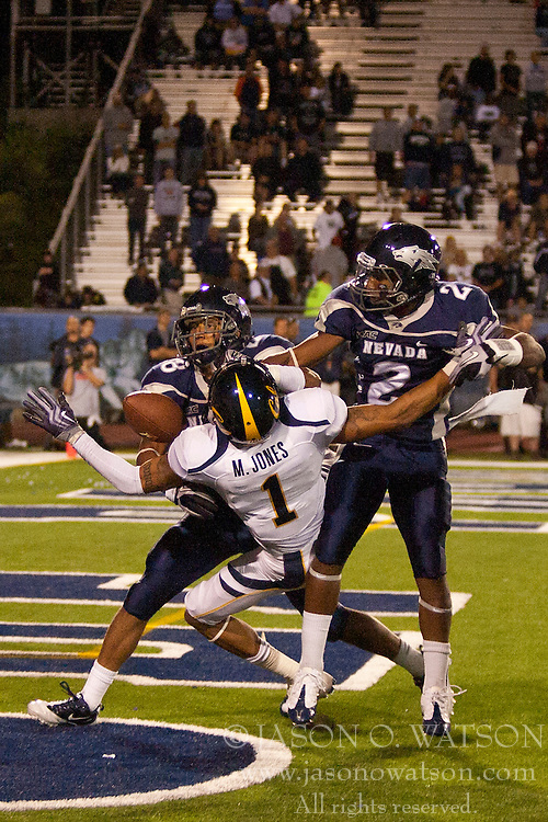 September 17, 2010; Reno, NV, USA; Nevada Wolf Pack cornerback Khalid Wooten (2) and cornerback Isaiah Frey (28) break up a pass intended for California Golden Bears wide receiver Marvin Jones (1) in the end zone during the fourth quarter at Mackay Stadium. Nevada defeated California 52-31.