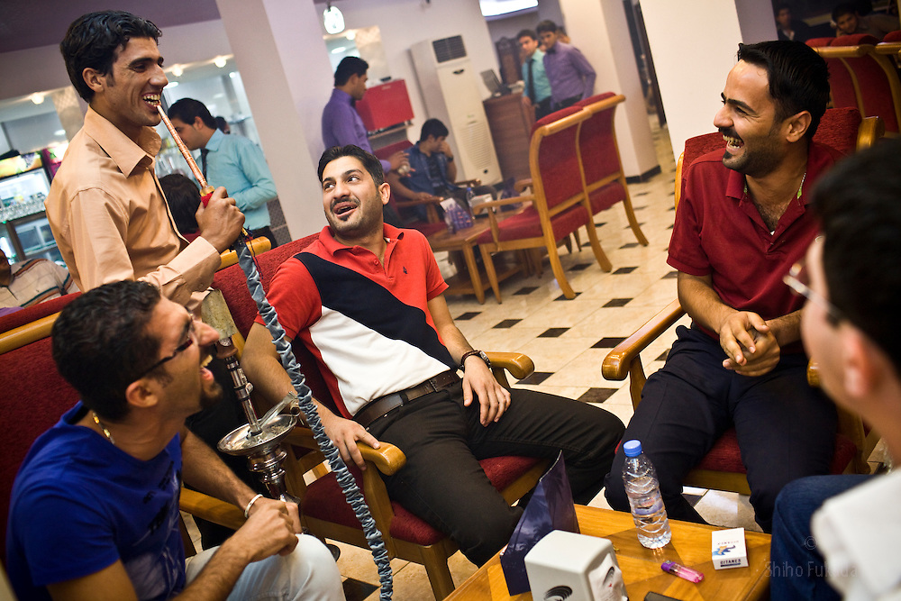 Men enjoy each other's company at hukkah cafe in Karadah district, Baghdad in Iraq.