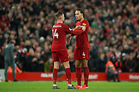 Football - 2019 / 2020 Premier League - Liverpool vs. Southampton<br /> <br /> Liverpool's Jordan Henderson hands the captains armband to Liverpool's Virgil van Dijk<br /> <br /> Colorsport / Terry Donnelly
