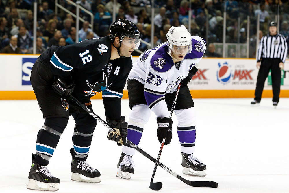 November 15, 2010; San Jose, CA, USA;  San Jose Sharks center Patrick Marleau (12) next to Los Angeles Kings right wing Dustin Brown (23) before a face off during the second period at HP Pavilion. San Jose defeated Los Angeles 6-3. Mandatory Credit: Jason O. Watson / US PRESSWIRE
