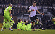 Derby County forward Chris Martin is tackled by Brighton central defender, Lewis Dunk (5) during the Sky Bet Championship match between Derby County and Brighton and Hove Albion at the iPro Stadium, Derby, England on 12 December 2015.