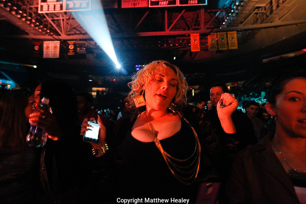 A woman dances during the warm up for the MMG Tour stop in, Providence, Rhode Island at the Dunkin Donuts Center on November, 16, 2012.  Photo by Matthew Healey