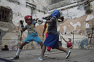 Training session at gimnasio de boxeo Ni&ntilde;os De Cuba - Havana - cuba<br /> <br /> The Cuban boxing has a centennial long prestigious history written by exceptional champions, artists of the ring, whose legendary exploits , continue to live in the stories of fans. In 1962 Cuba had abolished professionalism in sports. Two years ago, driven by economic interests and attempt to stop the bleeding of athletes on the run from the island, sports authorities have announced participation in world boxing championship, the World Series of Boxing (WSB), which are not however a professional circuit because they remain part of the Olympic boxing. Thanks to a law passed a few years ago, with new economic conditions for the Cuban athletes, now, in addition to the contributions they receive from the state, the Cuban boxers will earn from their sport, 80% of the proceeds from participation in international sporting events.<br /> Meanwhile two years ago, in a small corner of Centro Habana, two blocks from the Capitolio and the square of big international hotels such as Telegraph and England, between the peeling walls of two buildings, in the space left by a collapsed building,<br /> thanks also the association Italian Malaika (Angel in swahili), there is a gymnasium de Boxeo, a gym of wooden planks recycled for the children of Centro Habana. In this neighborhood gym the talent and enthusiasm of dozens of children between 7 and<br /> 20 years is concentrated: Los Ninos de Cuba. Every day from 5 pm until late at night they chasing their dreams of success, with ethics, rigor and commitment, The facilities are not enough for everyone. Gloves and shoes alternate in the hands and feet of small boxeadores, which in turn &ldquo;peleano&rdquo; on the makeshift ring waiting to make the leap to the Rafael Trejo, another Boxing Gymnasium, in the heart of Havana Vieja, to participate in provincial and then national championships. From these gyms the best of the little boxers move to the EIDE 