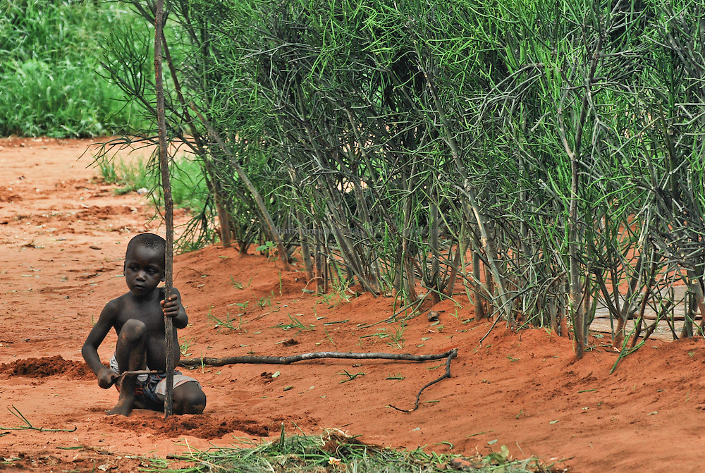 Young Boy with Stick, Simonga Village.<br />