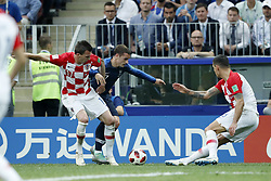 (L-R) Mario Mandzukic of Croatia, Antoine Griezmann of France, Dejan Lovren of Croatia during the 2018 FIFA World Cup Russia Final match between France and Croatia at the Luzhniki Stadium on July 15, 2018 in Moscow, Russia