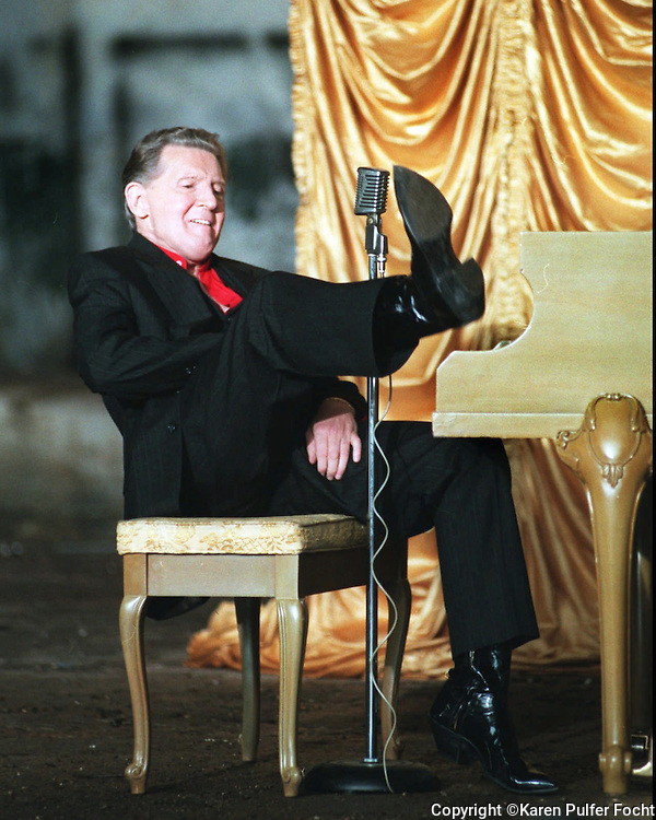 "Jerry Lee Lewis plays the piano in his usual style for a music video on his album.  The ""killer' says he will never retire.  1996."