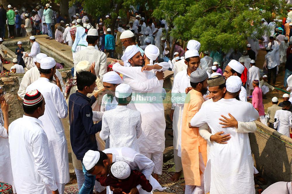 June 26, 2017 - Delhi, Rajasthan, India - Indian Muslims hug each others after offering Eid al-Fitr prayers at the Idgah Mosque in Delh-Jaipur Highway. Eid al-Fitr marks the end of the Muslims' holy fasting month of Ramadan. (Credit Image: © Vishal Bhatnagar/NurPhoto via ZUMA Press)