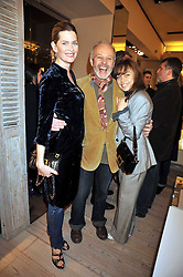 Left to right, MICHAEL & EMMA RADFORD and JEANNE MARINE at a reception in aid of Children in Crisis held at the Roger Vivier store, 188 Sloane Street, London on 19th March 2009.