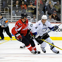 26 December 2007:  Tampa Bay Lightning center Vincent Lecavalier (4) skates in the first period against the defense of Washington Capitals center Viktor Kozlov (25) at the Verizon Center in Washington, D.C.  The Capitals defeated the Lightning 3-2.