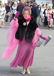 LIVERPOOL, ENGLAND - Friday, April 9, 2010: A female race-goer with a face mask of the Queen attends Ladies' Day during the second day of the Grand National Festival at Aintree Racecourse. (Pic by David Rawcliffe/Propaganda)