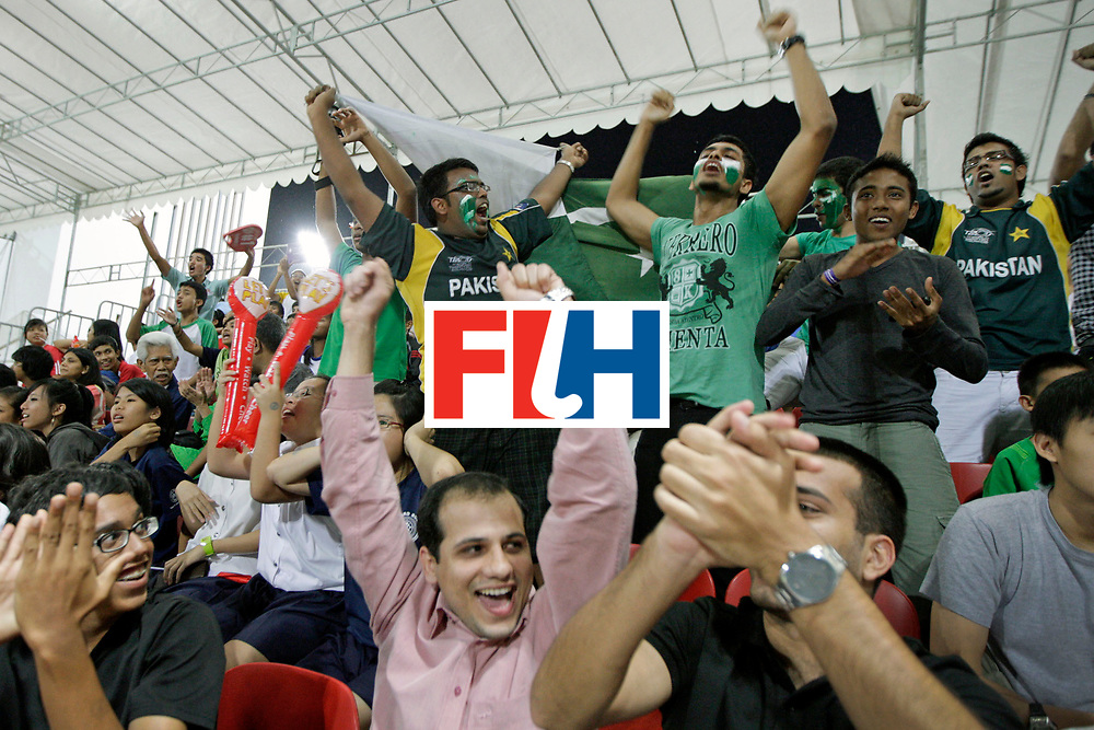 Pakistan's supporters on the stands react to a Pakistan goal during a preliminary boys' hockey match of the Singapore 2010 Youth Olympic Games (YOG) at the Sengkang Hockey Stadium in Singapore, Aug 20, 2010. Pakistan beat Singapore 4-1. Photo: SPH-SYOGOC/ Neo Xiaobin