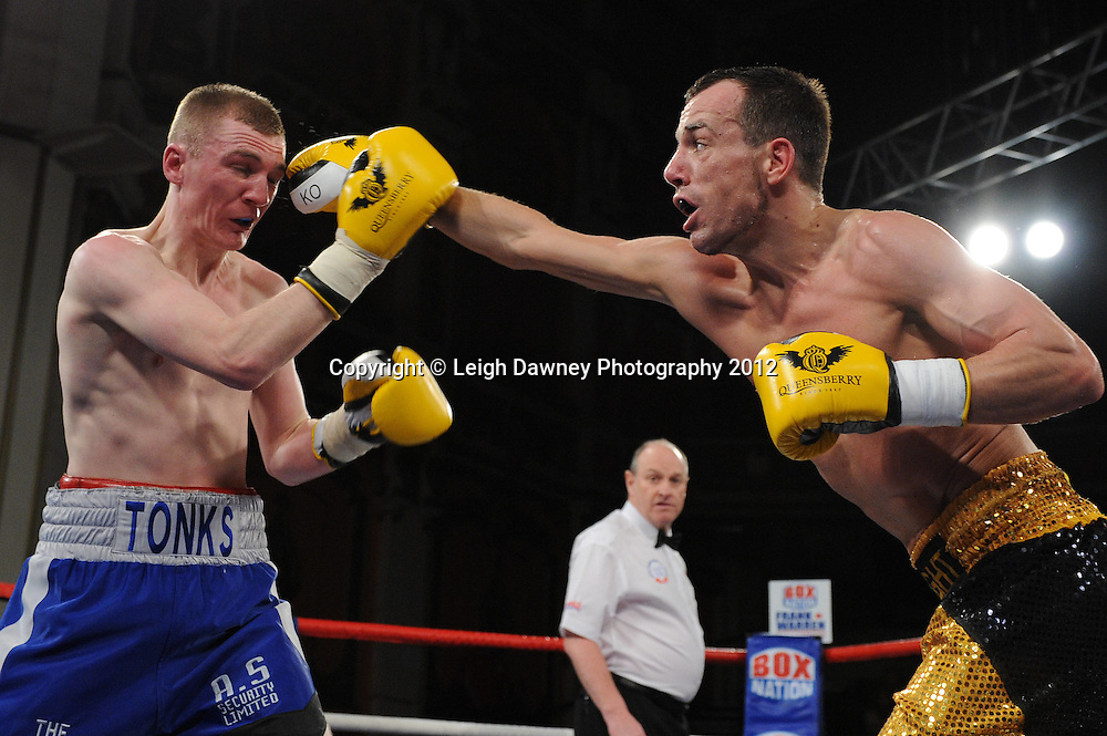 Joe Tonks (blue shorts) defeats Kristian Laight in a 4x3 min Light Welterweight contest at Olympia, Liverpool on the 21st January 2012. Vaughan Boxing Promotions. © Leigh Dawney Photography 2012.