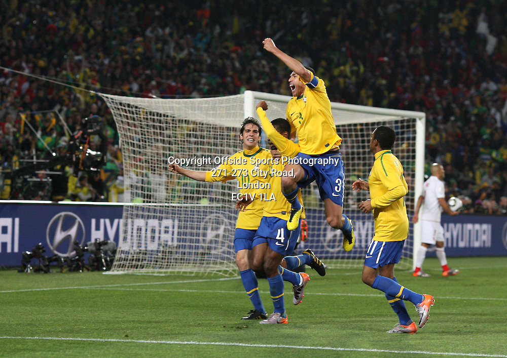 28/06/2010 - 2010 FIFA World Cup (Round of 16) - Brazil vs. Chile - Juan (2L) celebrates with teammates Kaka (L), Lucio (2R) and Robinho (R) after scoring the 1st goal for Brazil - Photo: Simon Stacpoole / Offside.