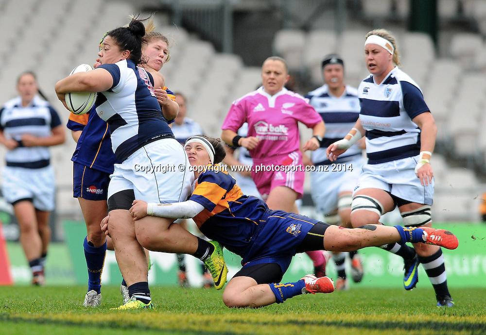 Auckland's Ana Taumalolo is tackled by Bay of Plenty's Billie Raynes in the Women's NPC rugby match, Bay of Plenty Volcanix vs Auckland, Rotorua International Stadium, Rotorua, September 13, 2014. Photo: Kerry Marshall / photosport.co.nz