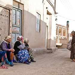 Group of old women chatting on the streets of Khiva, Uzbekistan, Asia.