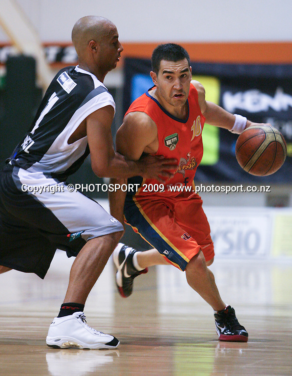 Shark's Luke Martin tries to get past Nat Connell. Hawkes Bay Hawks v Southland Sharks. National Basketball League. Pettigrew Green Arena, Napier, New Zealand. Friday 19 March 2010. Photo: John Cowpland/PHOTOSPORT