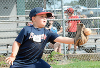 Charlie Gibson tries to catch the ball at first base during Who's on first baseball and softball camp hosted by Blount Community Church. The camp runs form Monday-Wednesday at the Alcoa Little League fields on Wright road.Joy Kimbrough | The Daily Times
